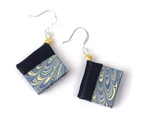 Book earrings are one of the best gifts for bookworms.